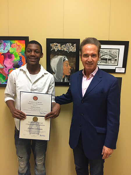 Congressman Higgins standing with Jaylen Coleman, grand prize winner of the Congressional District Art Competition